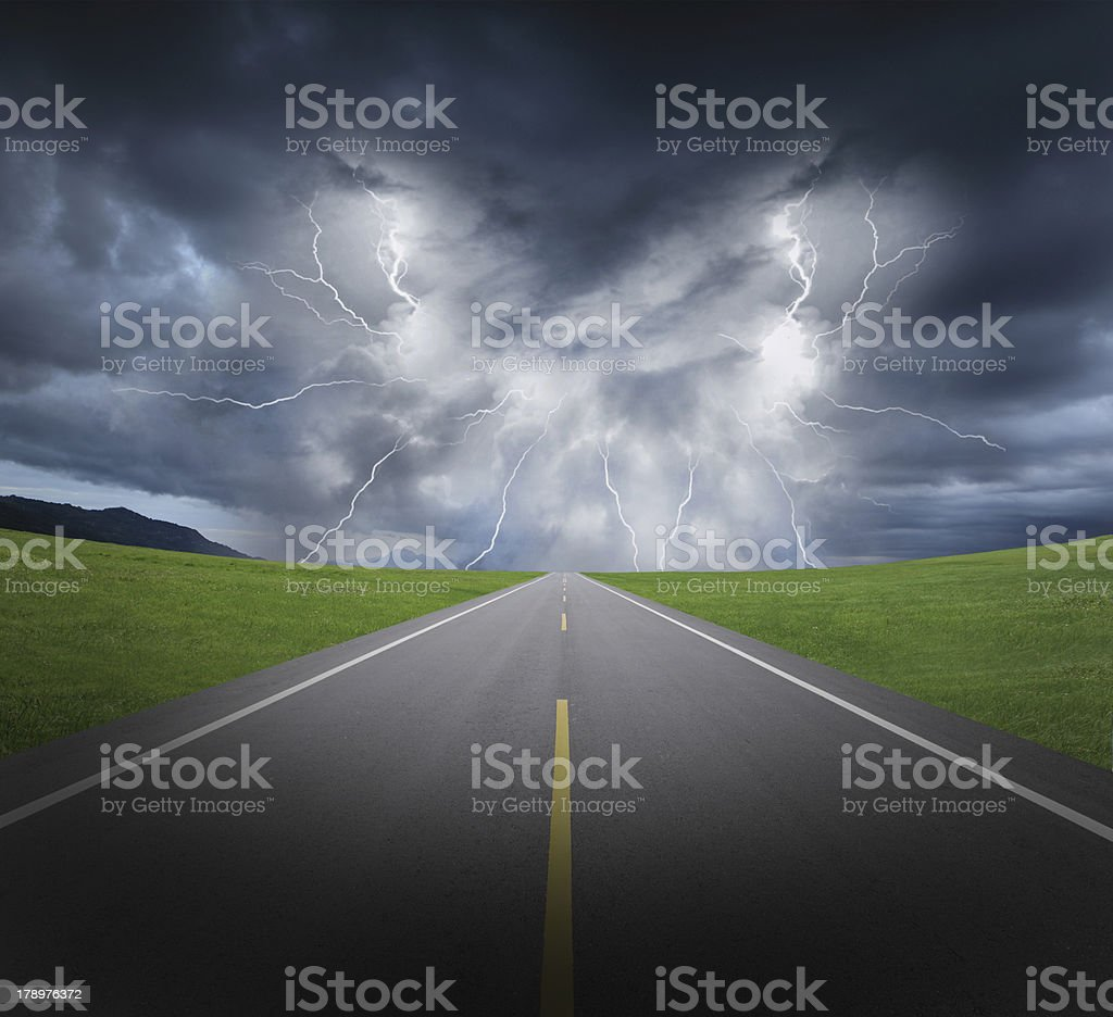 rainstorm clouds and lightning with asphalt road royalty-free stock photo