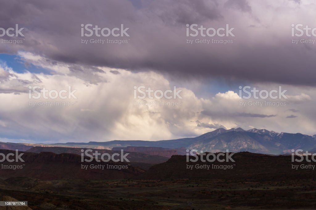 Rainstorm Crossing Arches National Park stock photo