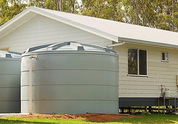 Rainwater conservation tanks on new house stock photo