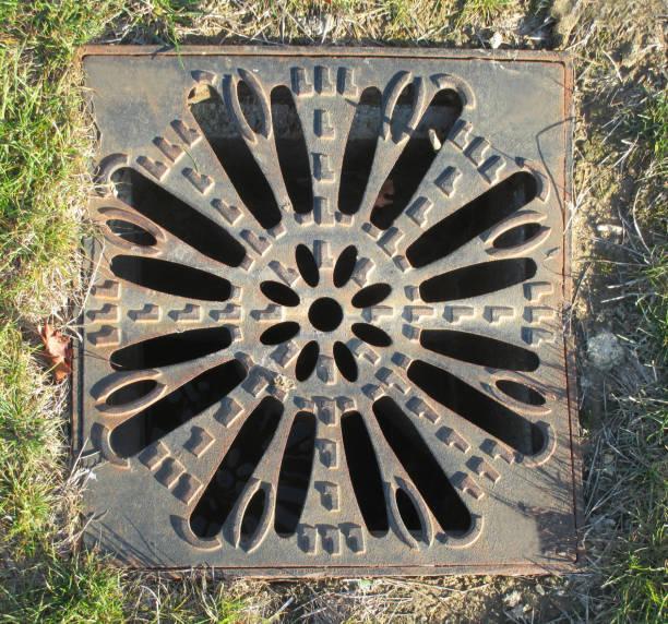 Cтоковое фото Rainwater flow grate  Steel grid