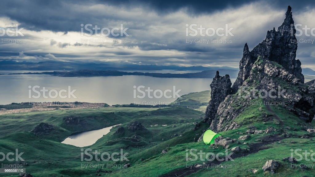 Rainy clouds over tent in Old Man of Storr, Scotland stock photo
