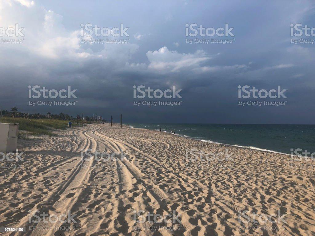 rainy day at the beach stock photo