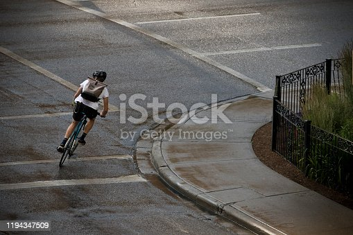 istock Rainy Day Bicycle Messenger 1194347509