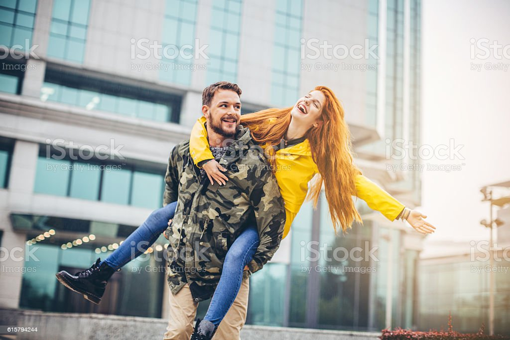 Rainy Day Piggyback Rides Stock Photo & More Pictures of 20-29 Years
