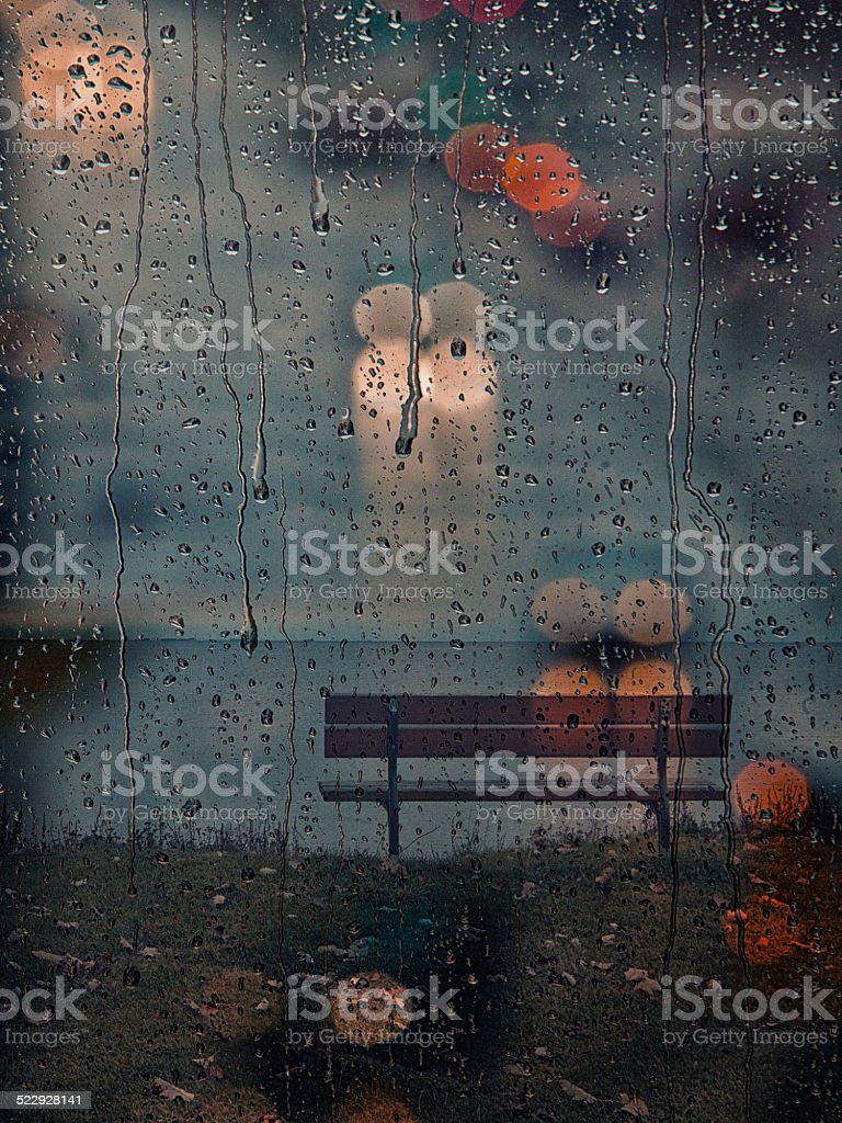 rainy days,rain drops on the window with traffic blur