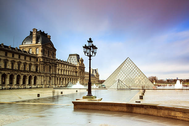Rainy Louvre Paris, France - February 19, 2014: Beautiful view of the Louvre museum in Paris, France, on February 19, 2014 musee du louvre stock pictures, royalty-free photos & images