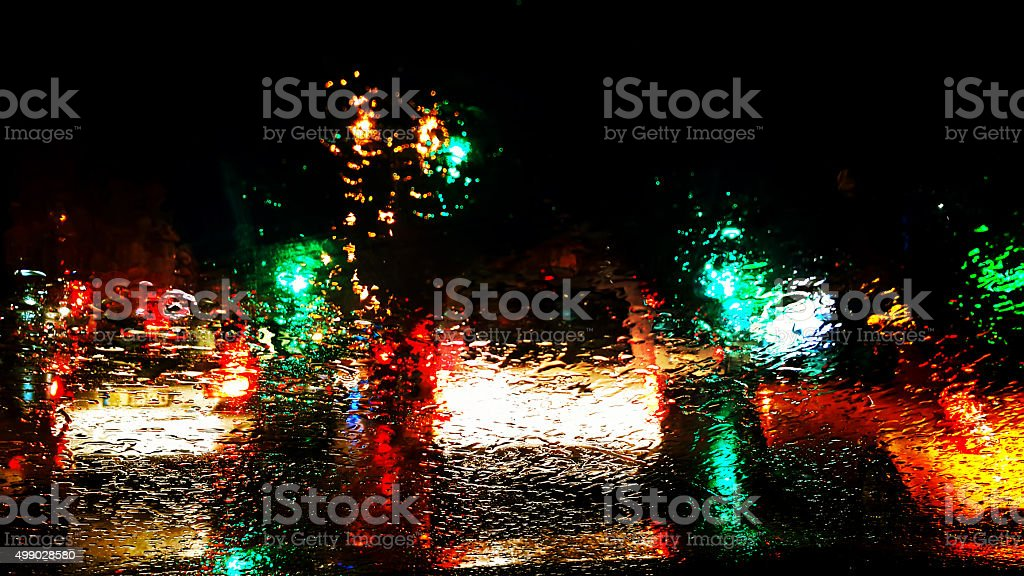 rainy night and traffic lights stock photo