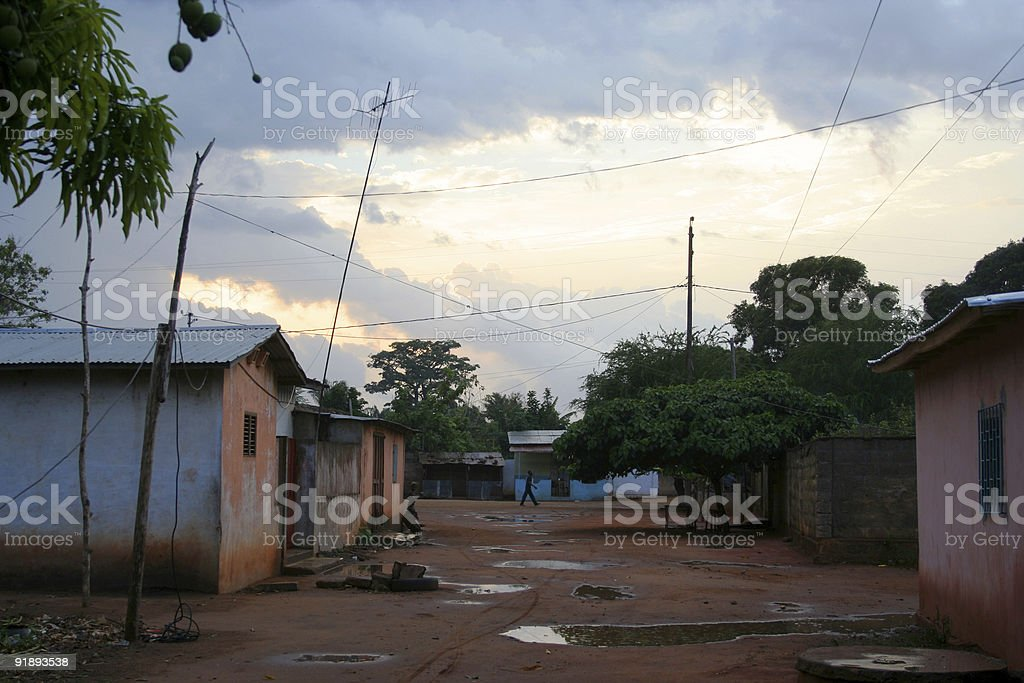 rainy night in african town stock photo