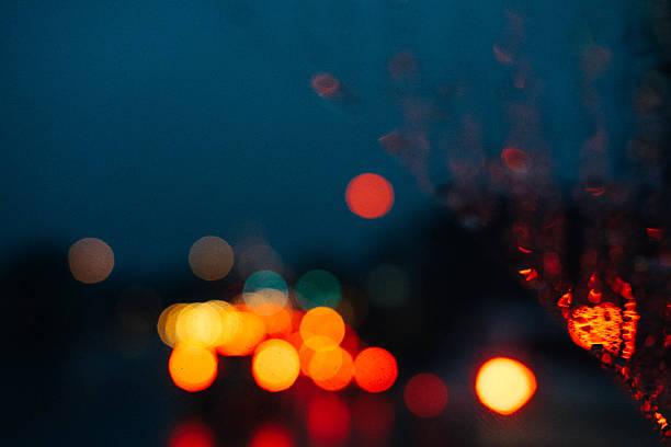 Rainy night windshield bokeh stock photo