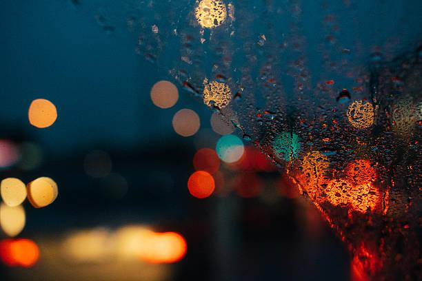 Rainy night windshield traffic view