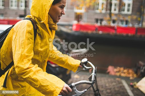 Woman riding a bike through Amsterdam