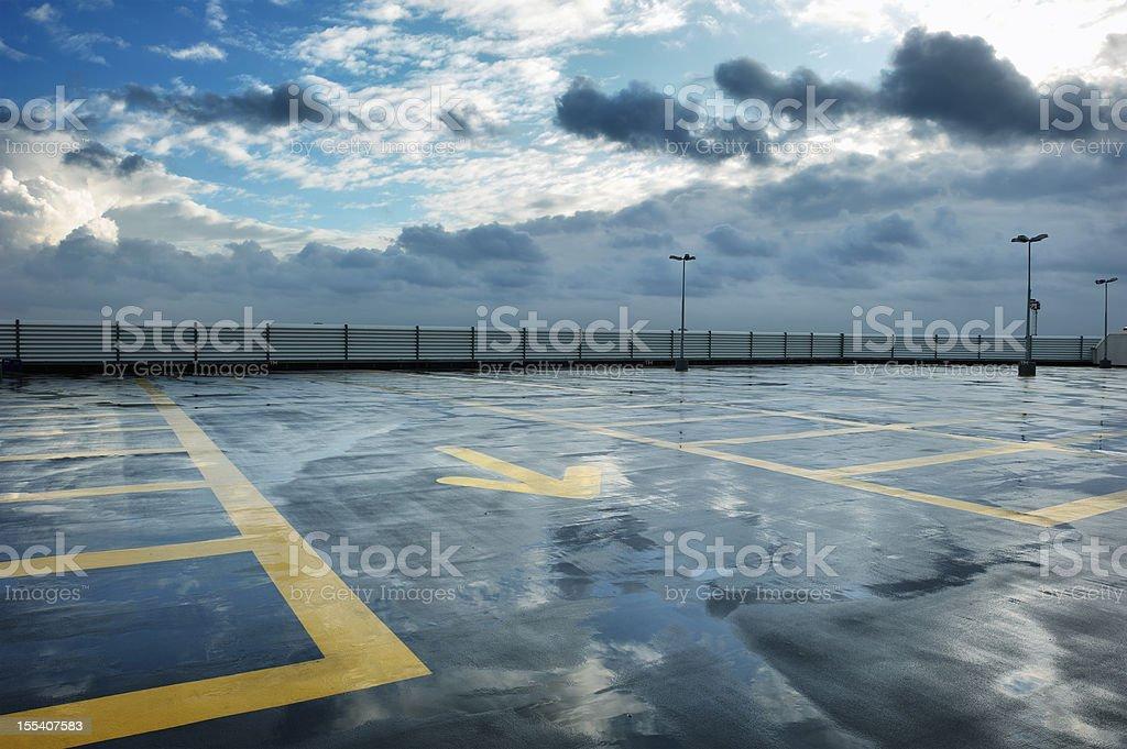 Rainy rooftop parking stock photo