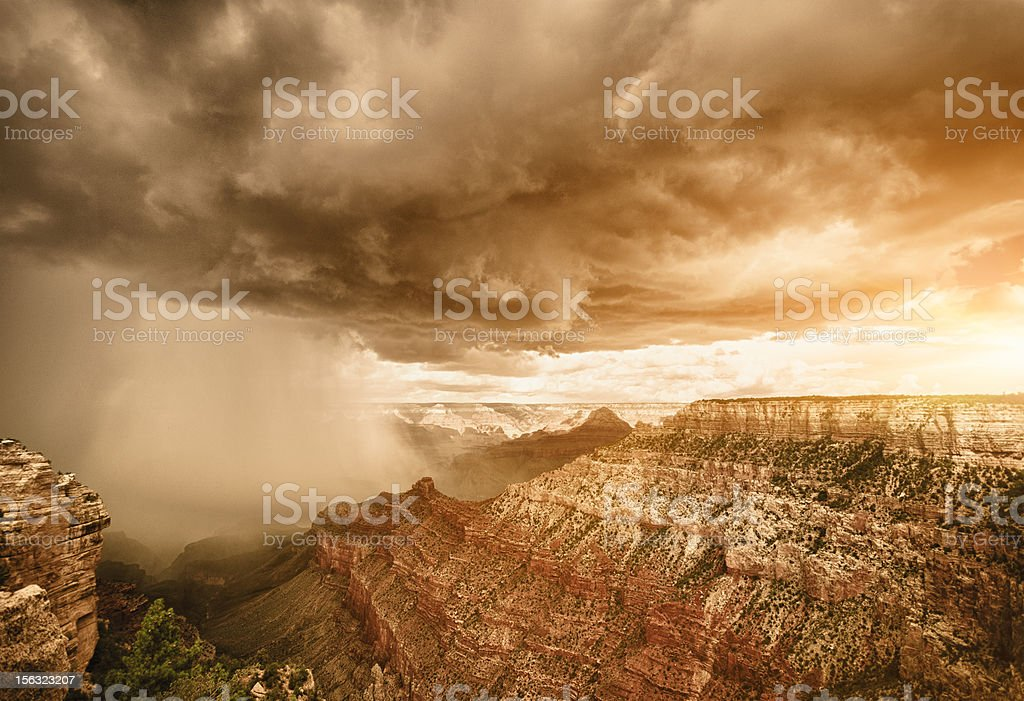 Rainy storm at sunset on Grand canyon - USA royalty-free stock photo