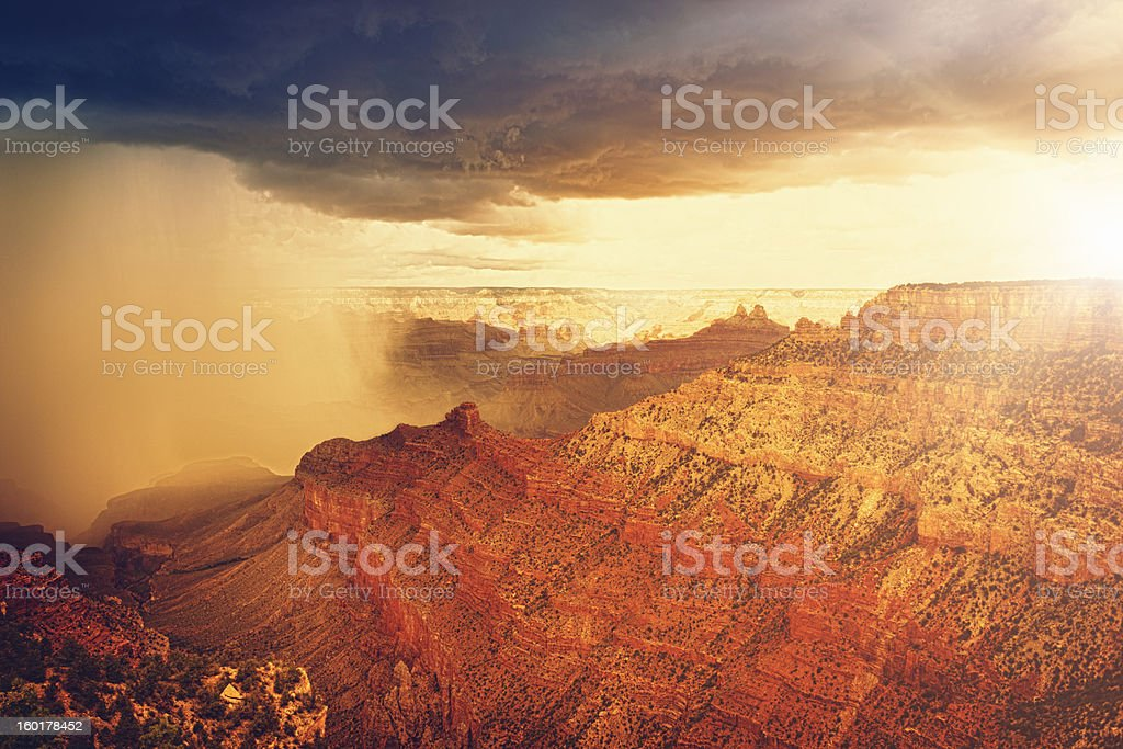 Rainy storm at sunset on Grand canyon - USA royalty-free stock photo