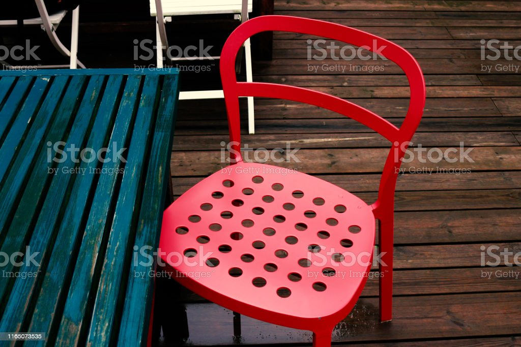 Picture of: A Rainy Terrace With Red Steel Chairs Stock Photo Download Image Now Istock