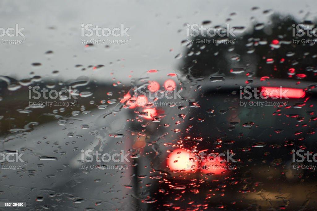 Rainy, bad view through windshield. Traffic jams at road block.