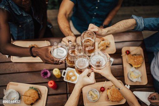 istock Raise your glasses for a toast. 699144432