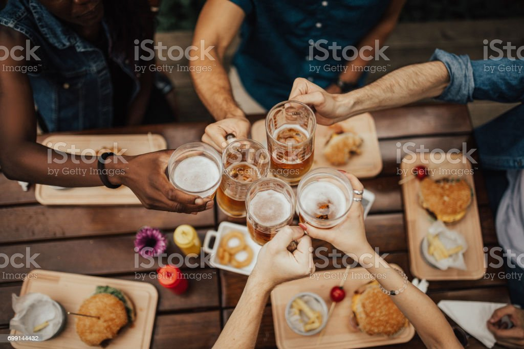 Raise your glasses for a toast. stock photo
