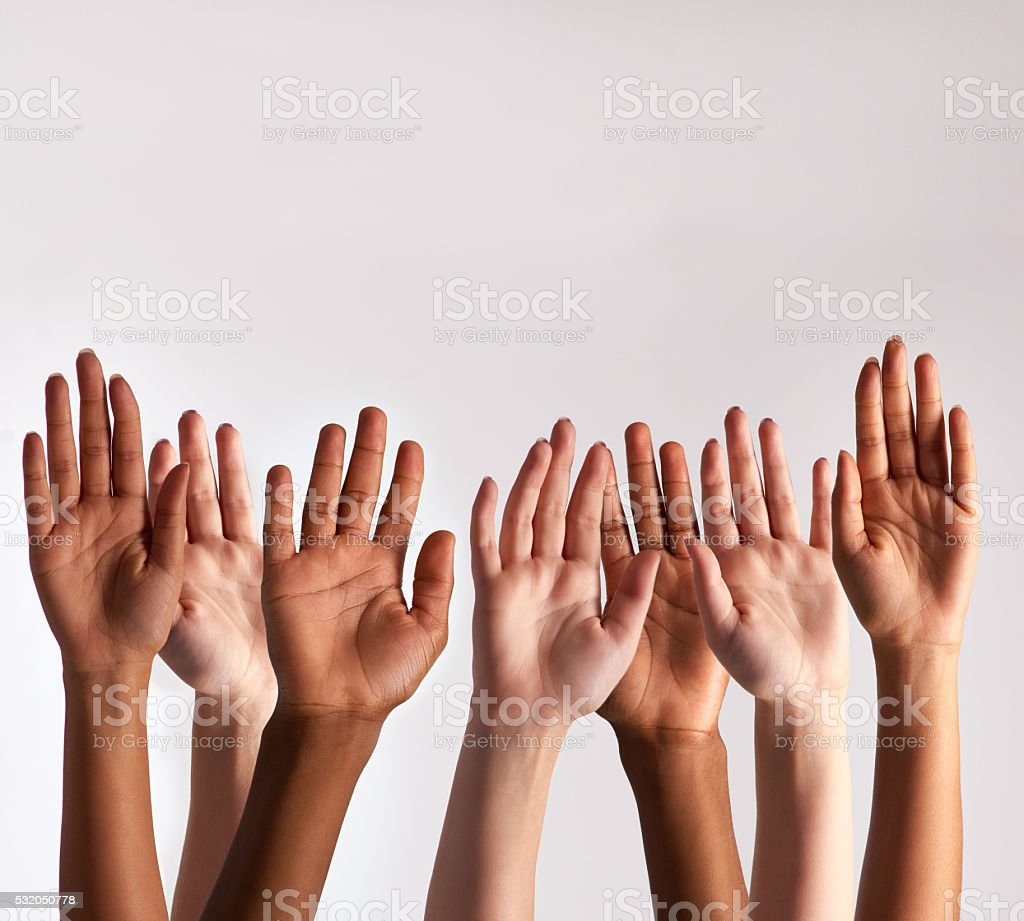 Raise your hands if you support diversity stock photo