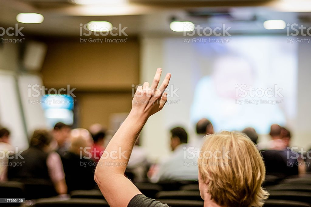 Raised arm  on seminar stock photo
