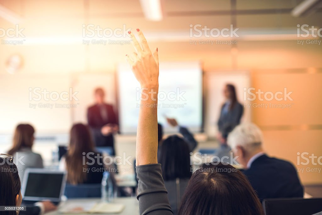 Raised hand, business seminar, education stock photo