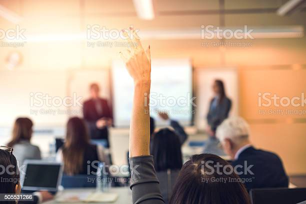 Raised Hand Business Seminar Education Stock Photo - Download Image Now