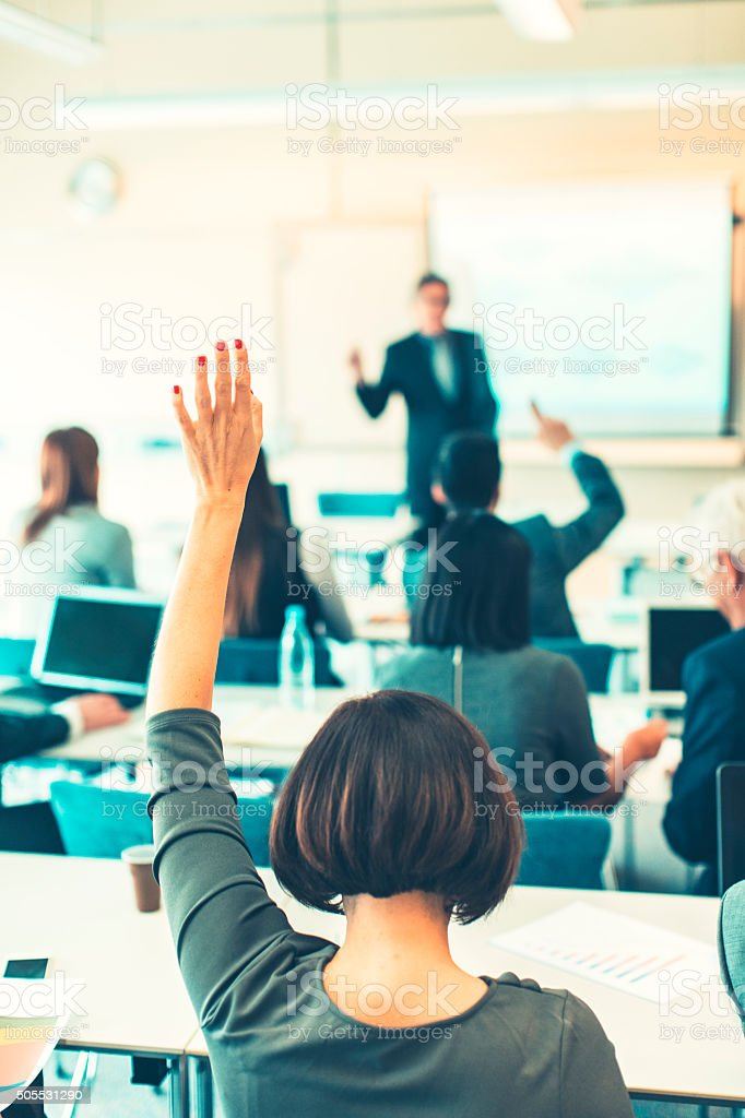 Raised hand, business seminar, education bildbanksfoto