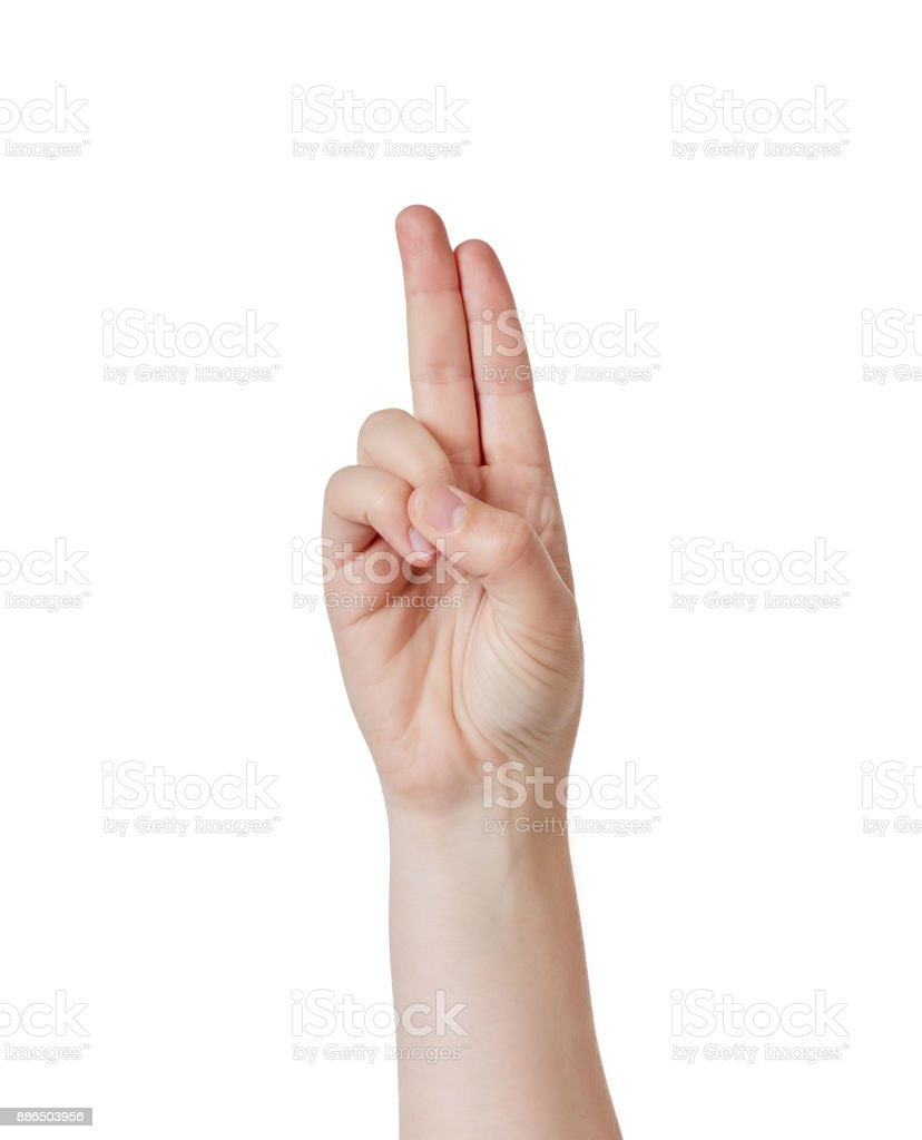 Raised hand makes the Cub Scout two-fingered salute stock photo