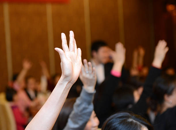 raised hand - voting hands stockfoto's en -beelden