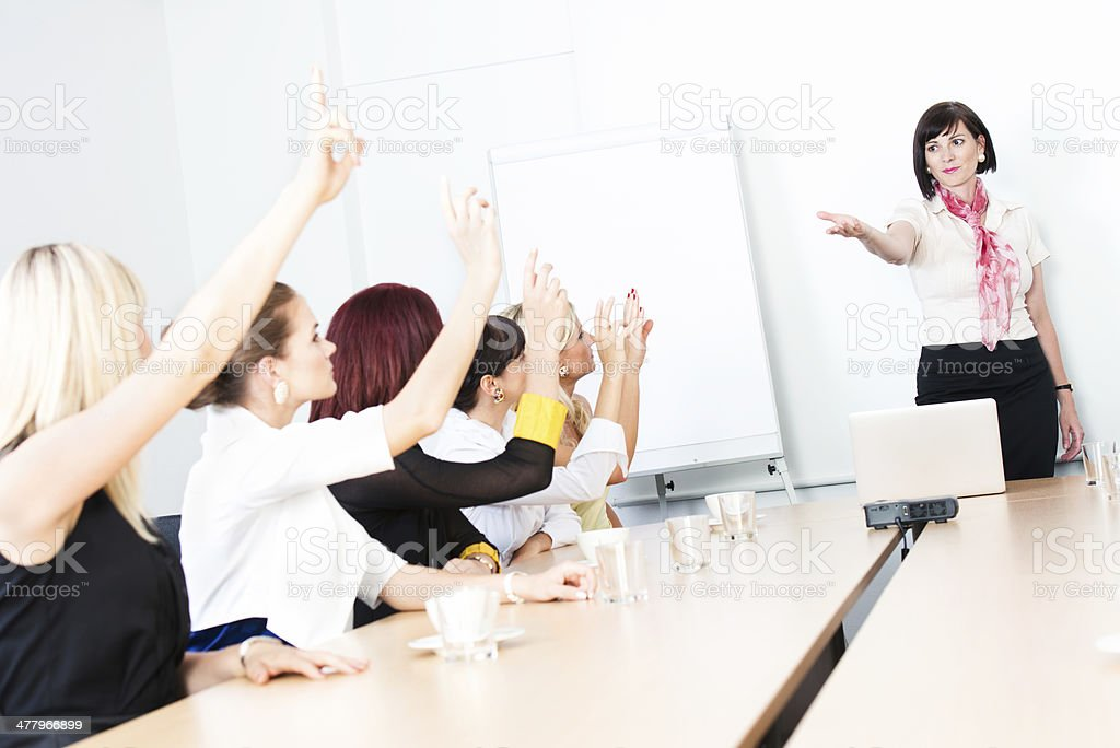 Raised hands at business presentation royalty-free stock photo