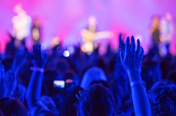 raised hands concert - praise and worship stock photos and pictures