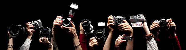 Raised hands holding photocameras picture id136217355?b=1&k=6&m=136217355&s=612x612&w=0&h=qyg9y0d14sxzp4kz1jpvcoijrp3fsdmige1onclkdsg=