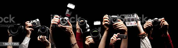 Raised Hands Holding Photocameras Stock Photo - Download Image Now
