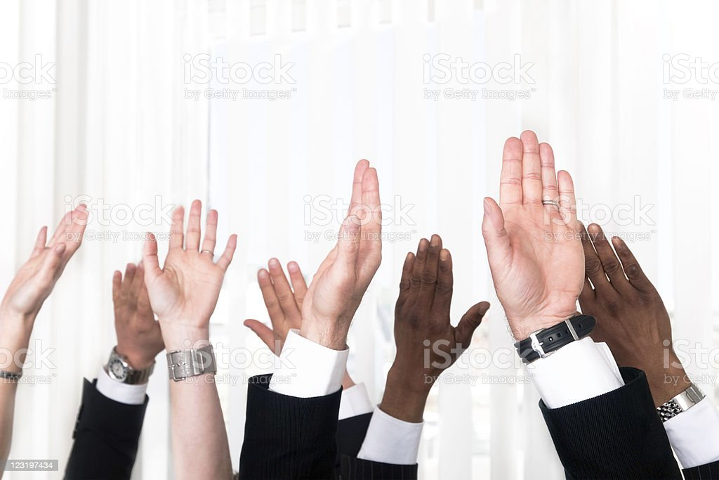 Raised hands royalty-free stock photo