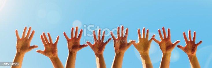 istock Raised hands 692794226