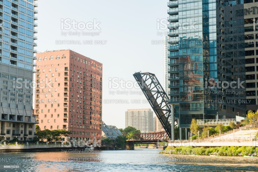 Raised Loop Bridge on Chicago River with Downtown Architecture stock photo