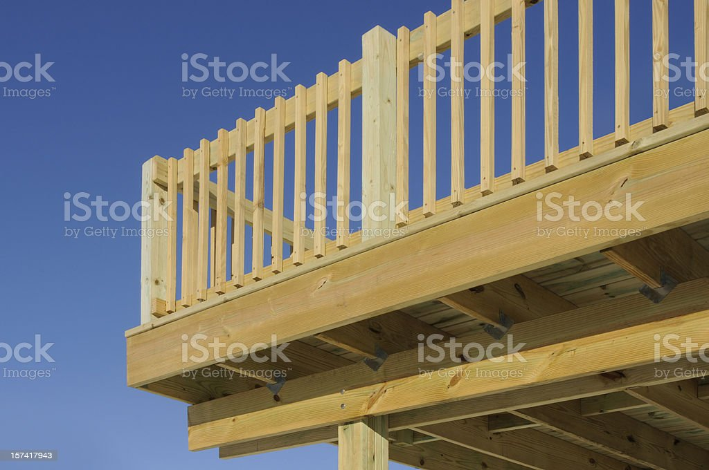 Raised New Pine Wood Deck Patio with Blue Sky Background royalty-free stock photo