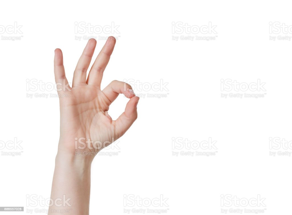 Raised right hand gives ' A OK' signal against white stock photo