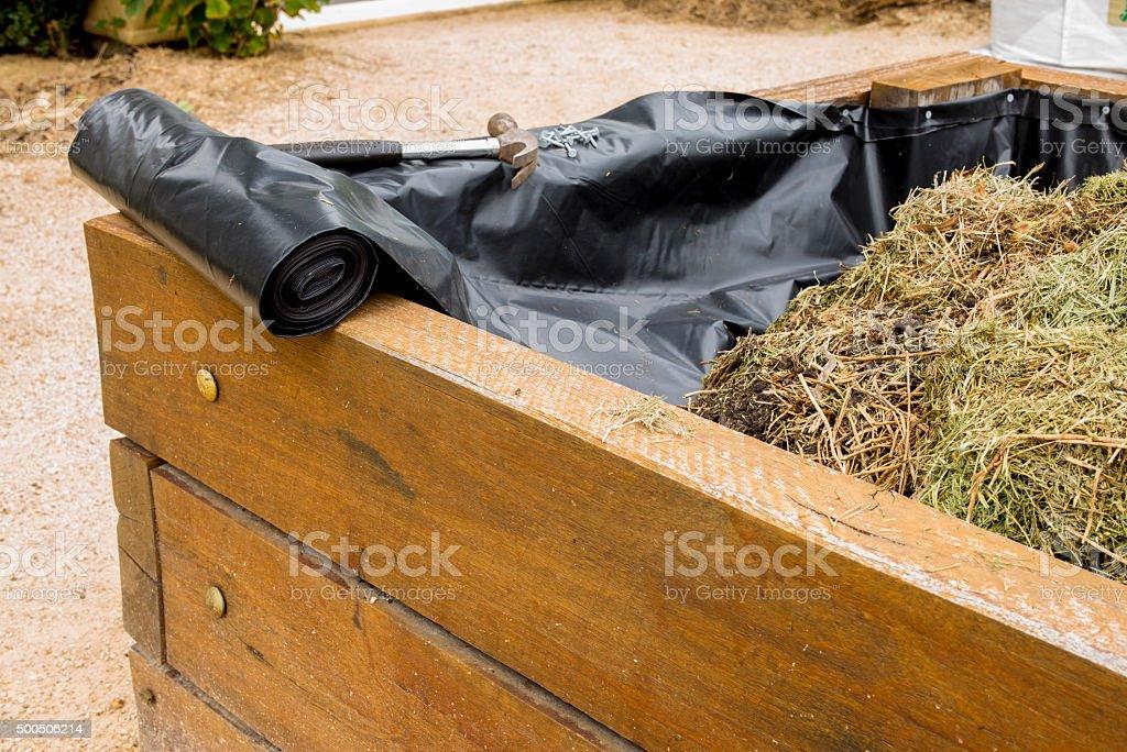 Raised vegetable garden bed stock photo