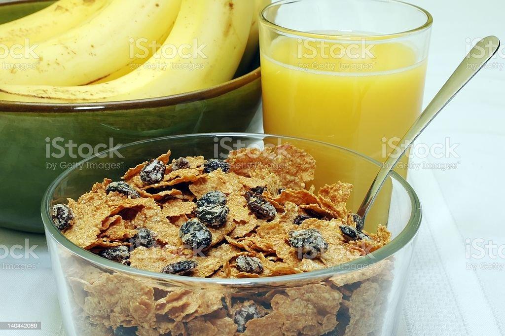 Raisin Bran, Orange Juice, and Bananas stock photo