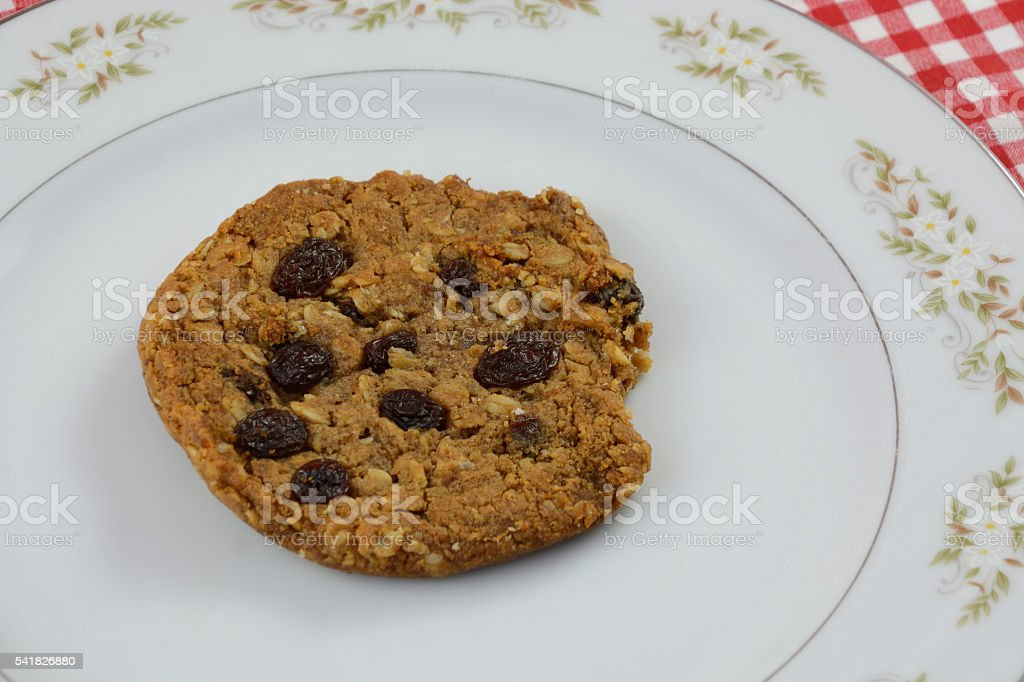 Raisin cookie on plate on talecloth stock photo