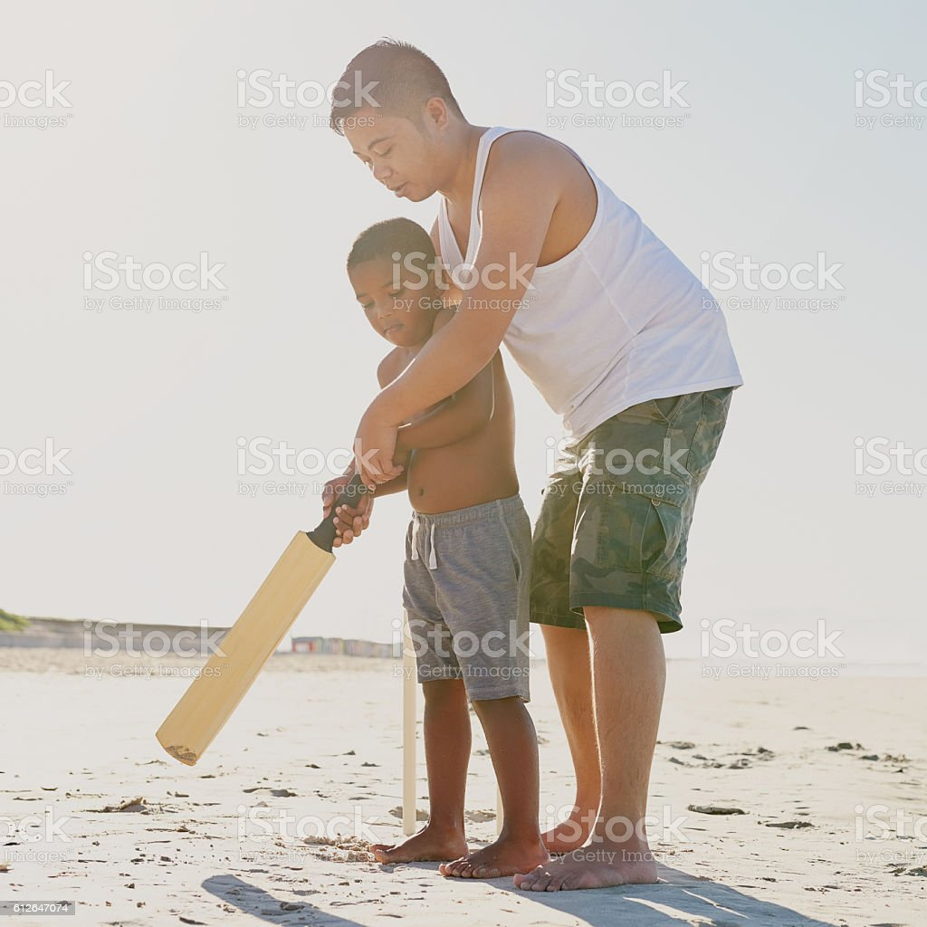 Raising a future cricket star stock photo