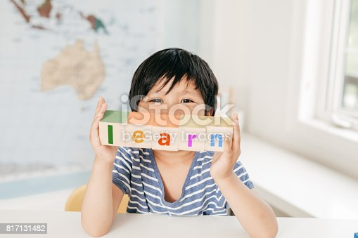 Boy holding blocks