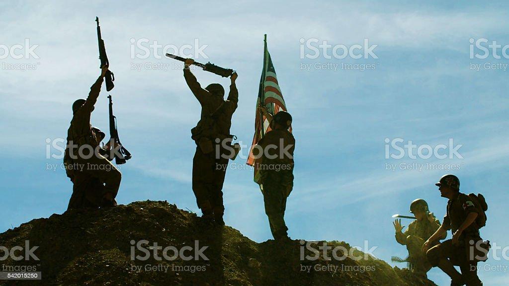 Raising American Flag stock photo