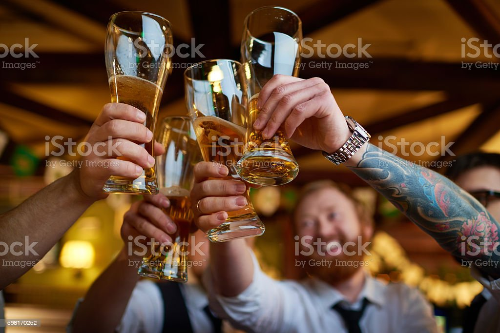 Raising glasses stock photo