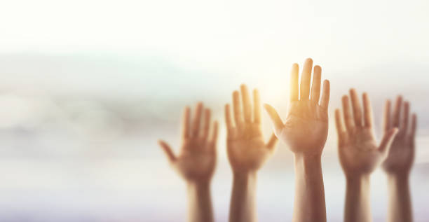 Raising Hands for Participation, many people's hands up. stock photo