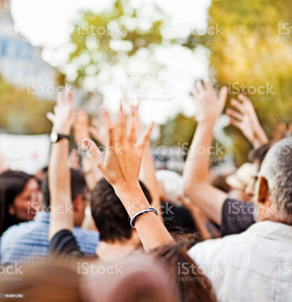 Raising hands royalty-free stock photo
