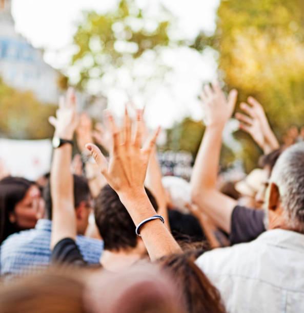 Raising hands stock photo