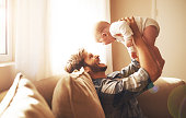 Cropped shot of a young father and his baby daughter in the living roomhttp://195.154.178.81/DATA/i_collage/pi/shoots/784147.jpg