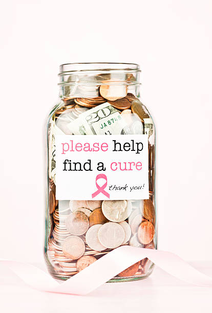 денег по исследованию рака груди - breast cancer awareness стоковые фото и изображения